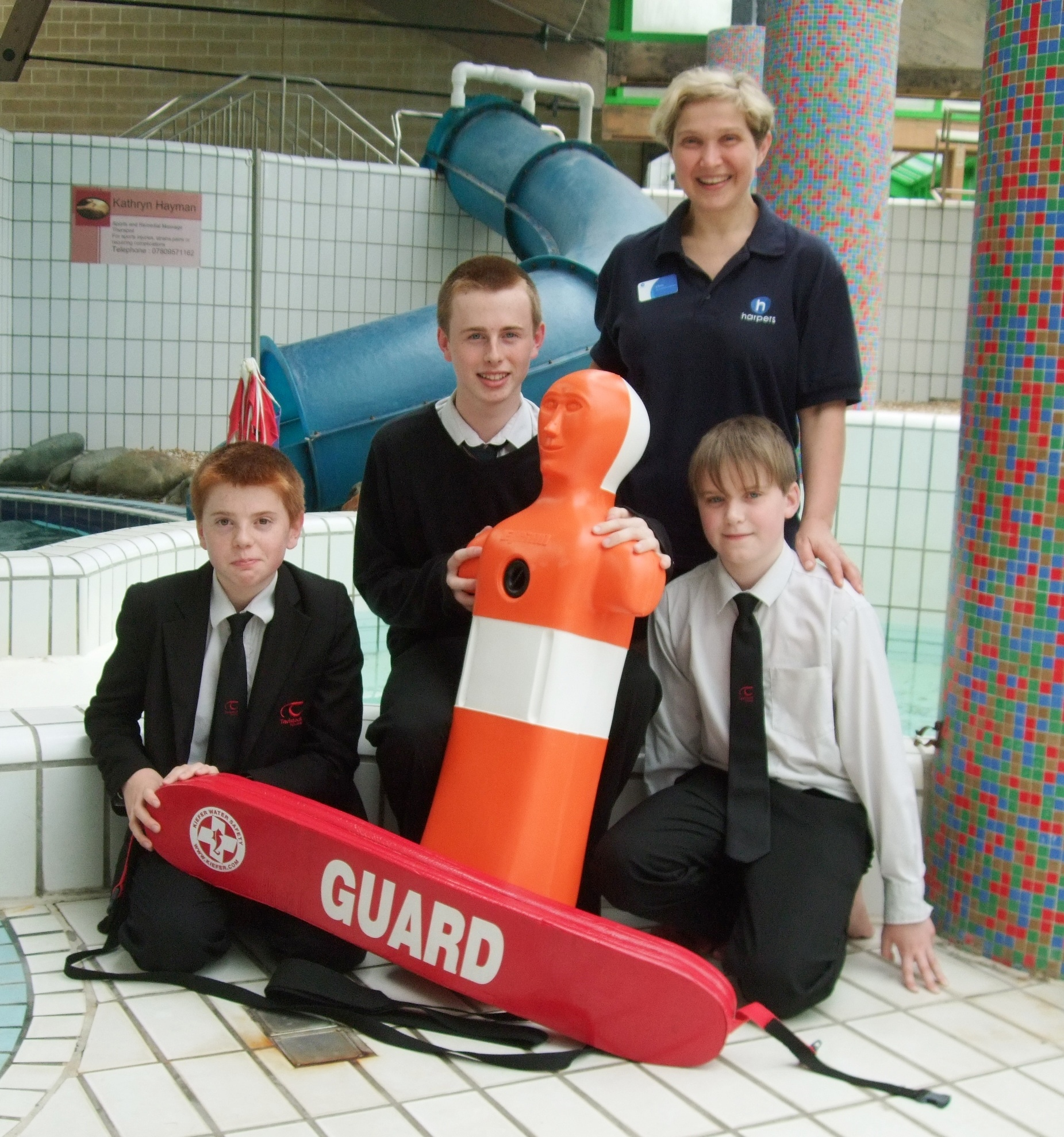 The Carver brothers with Swim Coordinator, Clare Short and Sinking Sid.