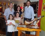 Image: Lisa with her family and Damian Dolinski, Assistant Manager.