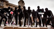 LONDONERS TAKE TO THE STREETS IN MORPHSUITS IN ANONYMOUS 'UNRIOT' TO MARK ANNIVERSARY OF VIOLENCE