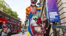 Horrifying clown towering above at London Fashion Week - Morphsuits Photo - Paul Clarke