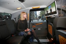 Gabriella Griffith watching the conference streamed live at the back of a London Taxi