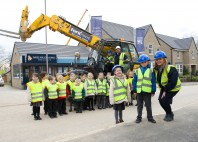 Local school children visit luxury-housing site to learn how a building stays up