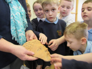 Local housebuilder delivers talk to primary school following ancient findings at Barlby site