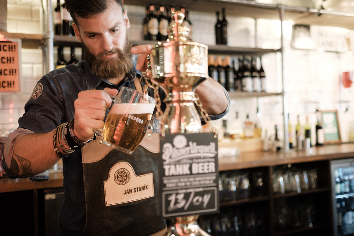 Tapster pouring Pilsner