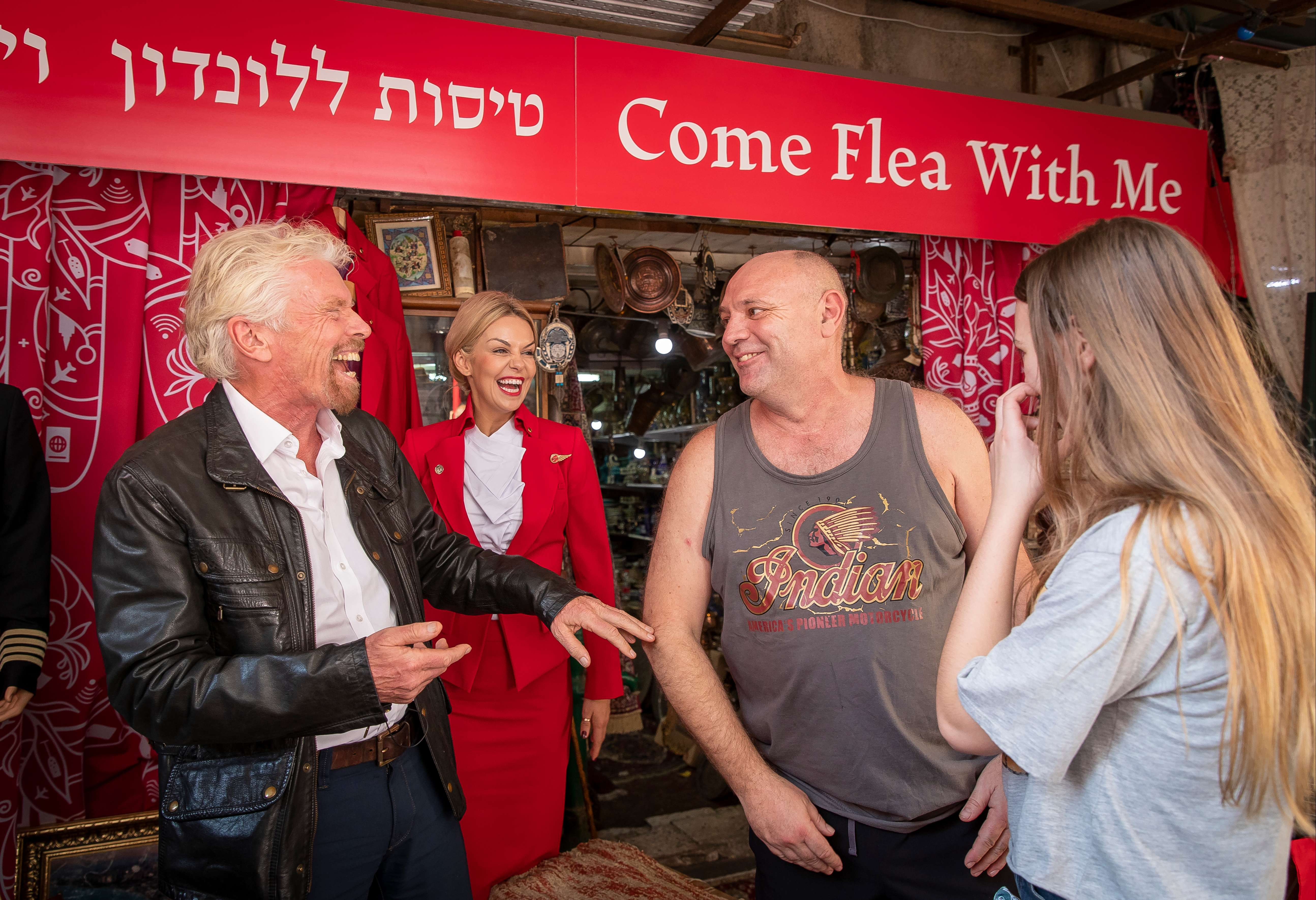 To celebrate Virgin Atlantic's inaugural flight to Tel Aviv, Virgin founder and international Businessman Sir Richard Branson operates a pop-up travel agency in the middle of the city's famous Jaffa Market The Secret Travel Agent initiative celebrates  Tel Aviv's social practice of haggling as its residents negotiate with this business giant for flights to London Sir Richard also threw in additional items such as flight bags and Virgin Atlantic merchandise to tempt his customers to make a deal, mirroring Virgin Atlantic's ethos of maximising customer experience with added extras The twist is Sir Richard will be giving away a limited number of flights to London for those who are the fiercest negotiators.